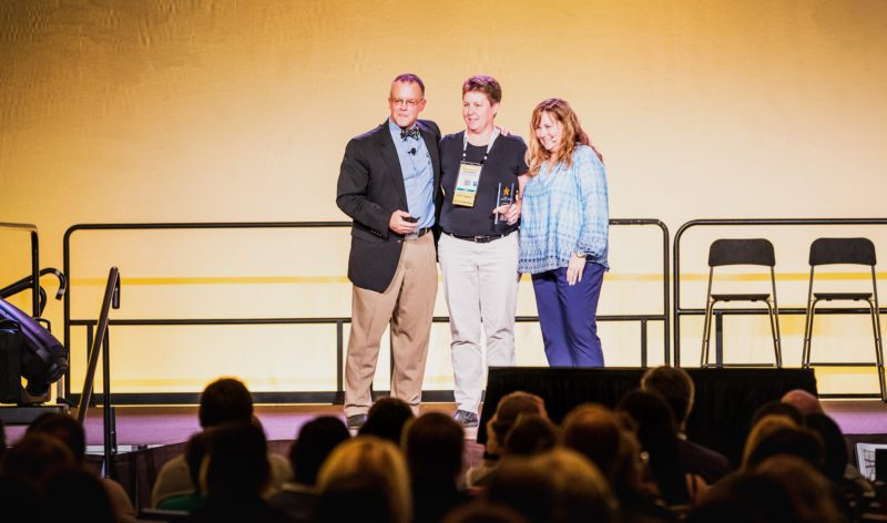Bob McAdam, myself and Lisa Lucas on stage at GPUG Summit 2018, receiving my award.
